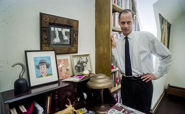 John Waters, film producer/director, in his home.