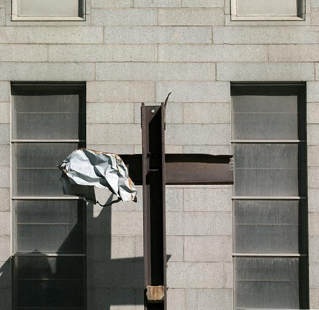 Rements form a cross from the 9/11 World Trade Center disaster.